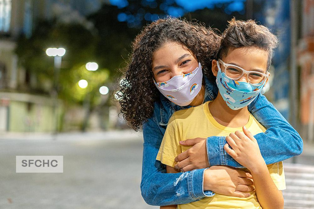 Mom and middle-school aged child happy they are vaccinated against Covid-19