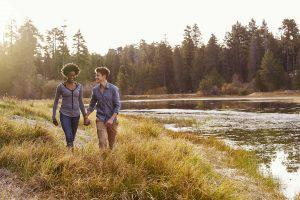 image of couple walking in nature