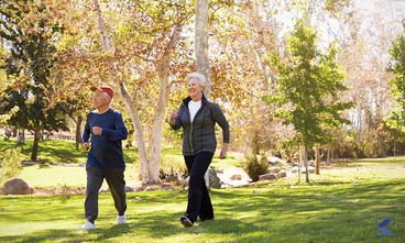 Older couple exercising in the park